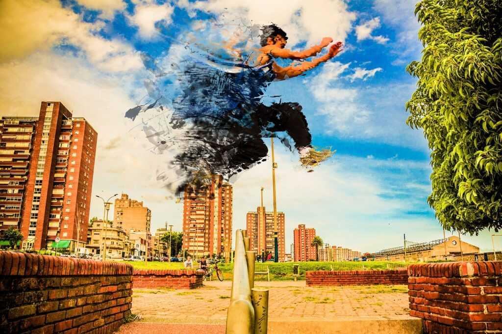 muž skáče přes zábradlí